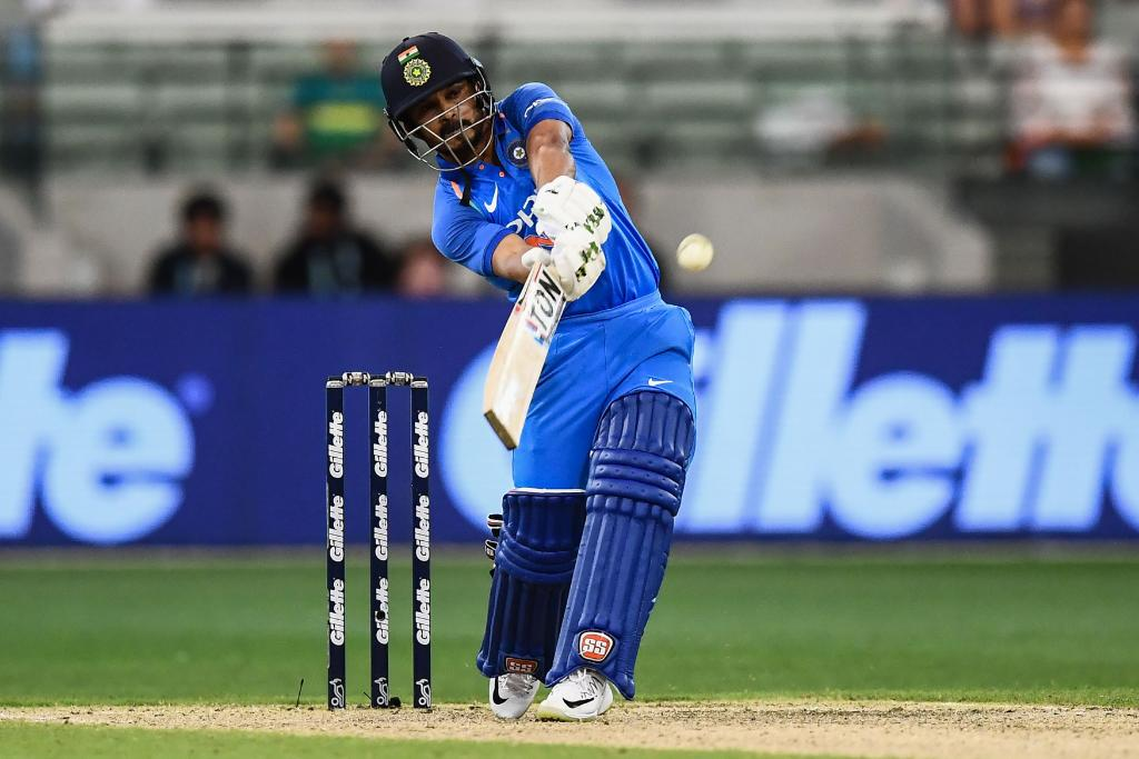Kedar Jadhav hits a shot versus Australia in the third ODI at the MCG in January 2019. (Image: Twitter @ICC)