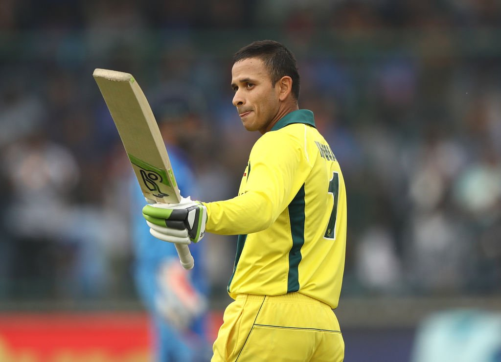 Usman Khawaja raises his bat after a ton against India in ODIs. (Image: Twitter @BCCI)