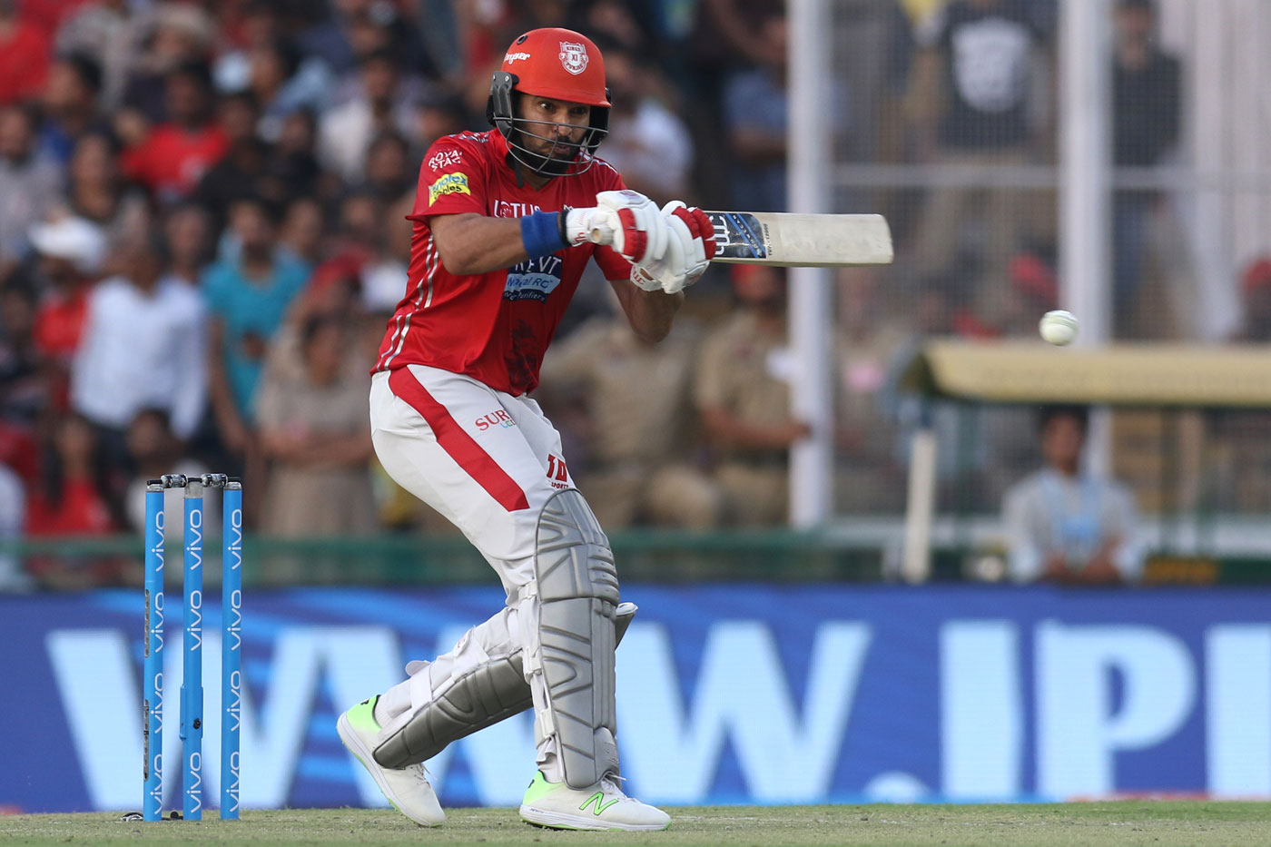 Yuvraj Singh plays a shot for KXIP In IPL 11. (Image: cricketaddictor.com)