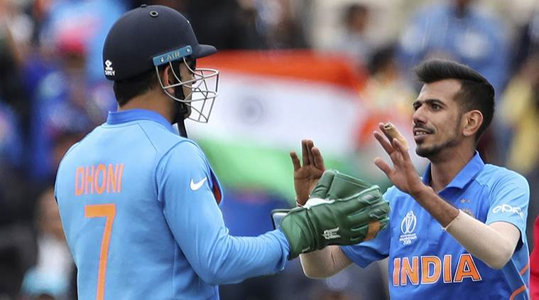 India's Yuzvendra Chahal, right, celebrates with teammate MS Dhoni the dismissal of South Africa's Andile Phehlukwayo during the Cricket World Cup match between South Africa and India at the Hampshire Bowl in Southampton, England, Wednesday, June 5, 2019. (AP Photo/Aijaz Rahi)